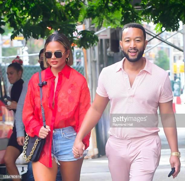 Chrissy Teigen and John Legend are seen walking in SoHo on August 20, 2021 in New York City.