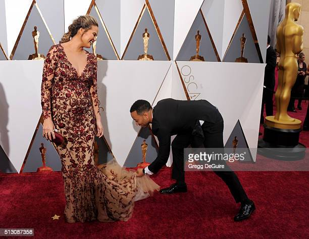 Chrissy Teigen and John Legend arrive at the 88th Annual Academy Awards at Hollywood & Highland Center on February 28, 2016 in Hollywood, California.