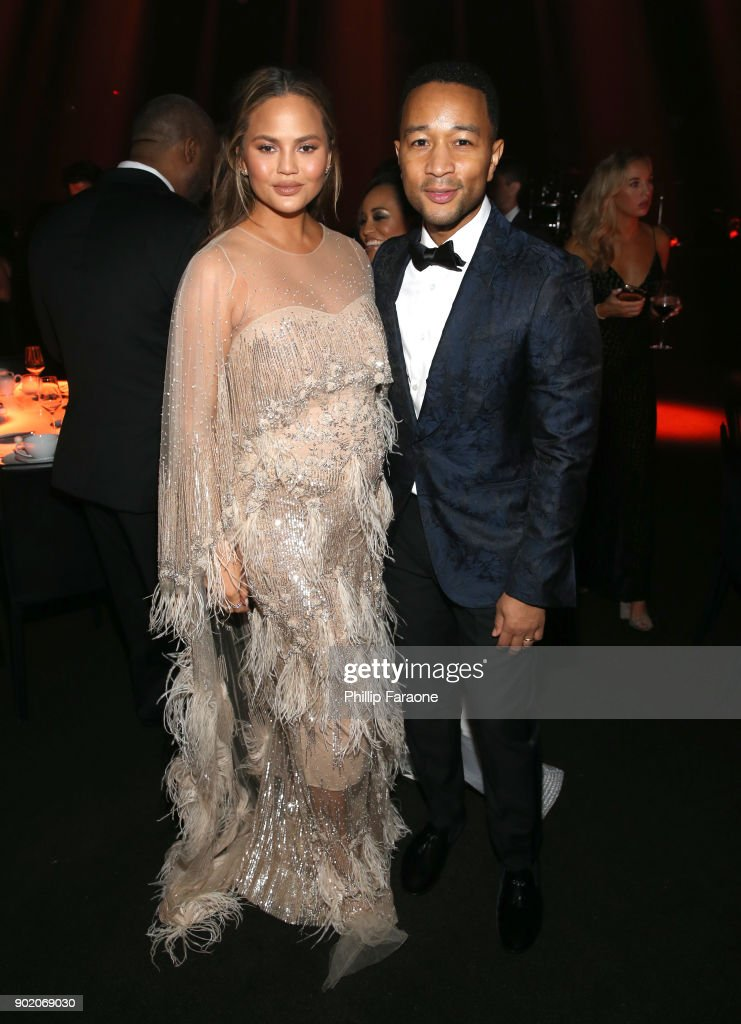 Chrissy Teigen (L) and John Legend at The Art Of Elysium's 11th Annual Celebration with John Legend at Barker Hangar on January 6, 2018 in Santa Monica, California.
