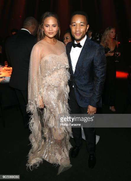 Chrissy Teigen and John Legend at The Art Of Elysium's 11th Annual Celebration with John Legend at Barker Hangar on January 6 2018 in Santa Monica...