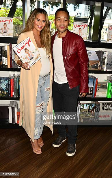 Chrissy Teigen and John Legend attend a book signing for Cravings at Books and Books At Adrienne Arsht Center on February 26 2016 in Miami Florida