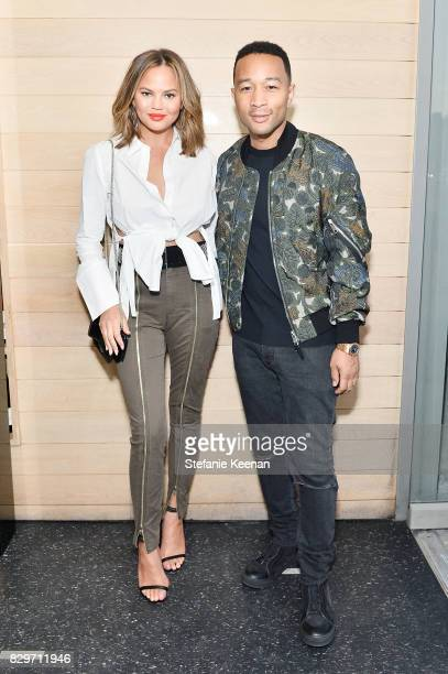 Chrissy Teigen and John Legend attend INTERMIX x ALC On Duty Launch Dinner with Chrissy Teigen at Jon and Vinny's on August 10 2017 in Los Angeles...