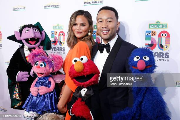 Chrissy Teigen and John Legend attend Sesame Workshop's 50th Anniversary Benefit Gala at Cipriani Wall Street on May 29 2019 in New York City