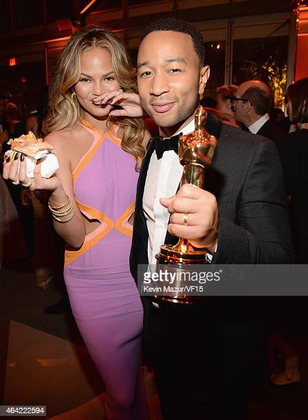 Chrissy Teigen and John Legend attend the 2015 Vanity Fair Oscar Party hosted by Graydon Carter at the Wallis Annenberg Center for the Performing...