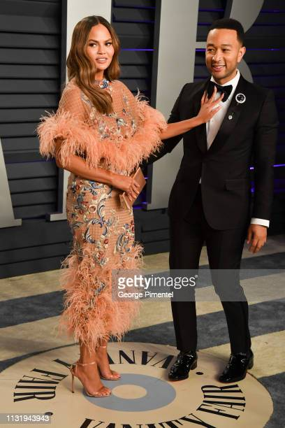 Chrissy Teigen and John Legend attend the 2019 Vanity Fair Oscar Party hosted by Radhika Jones at Wallis Annenberg Center for the Performing Arts on...