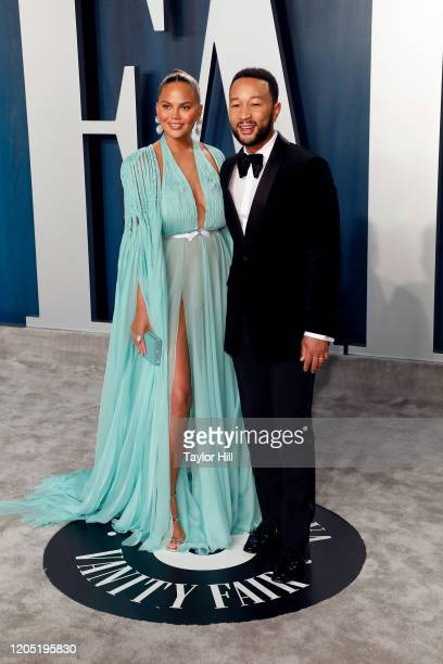 Chrissy Teigen and John Legend attend the 2020 Vanity Fair Oscar Party at Wallis Annenberg Center for the Performing Arts on February 09 2020 in...