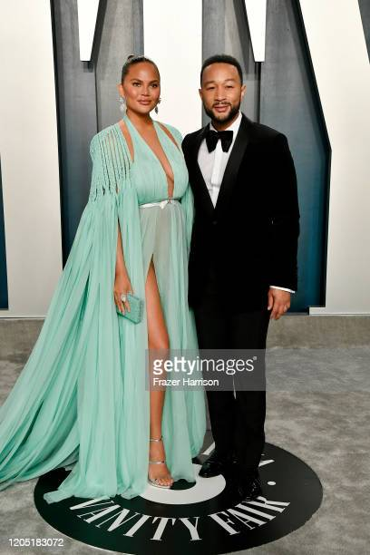 Chrissy Teigen and John Legend attend the 2020 Vanity Fair Oscar Party hosted by Radhika Jones at Wallis Annenberg Center for the Performing Arts on...