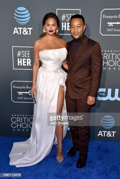 Chrissy Teigen and John Legend attend the 24th Annual Critics' Choice Awards at Barker Hangar on January 13 2019 in Santa Monica California