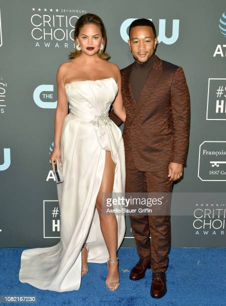 Chrissy Teigen and John Legend attend the 24th annual Critics' Choice Awards at Barker Hangar on January 13 2019 in Santa Monica California