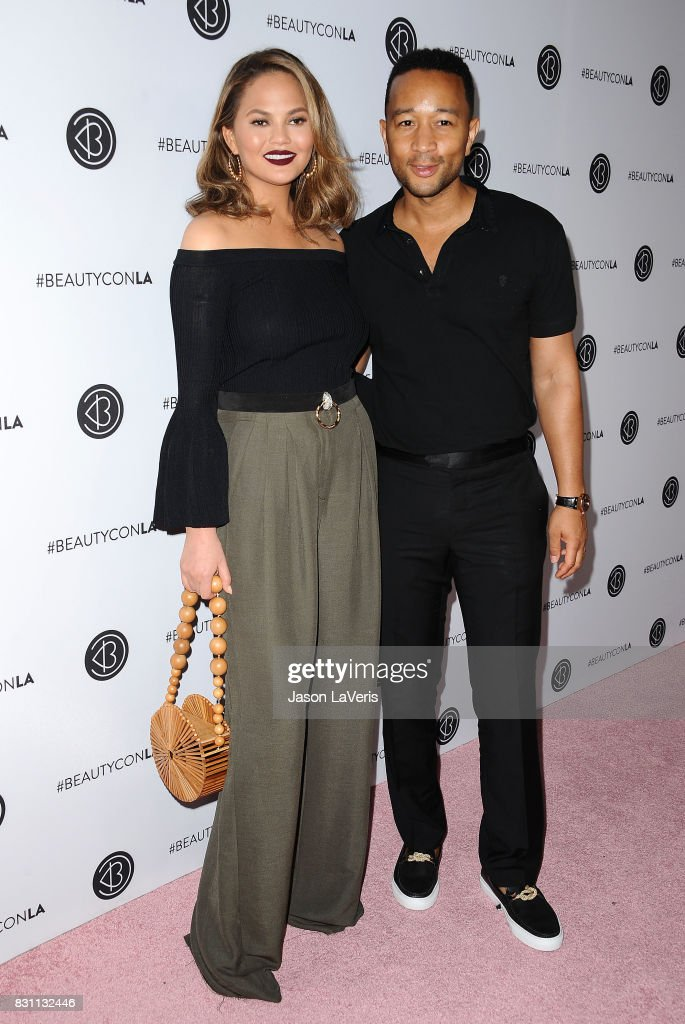 Chrissy Teigen and John Legend attend the 5th annual Beautycon festival at Los Angeles Convention Center on August 13, 2017 in Los Angeles, California.