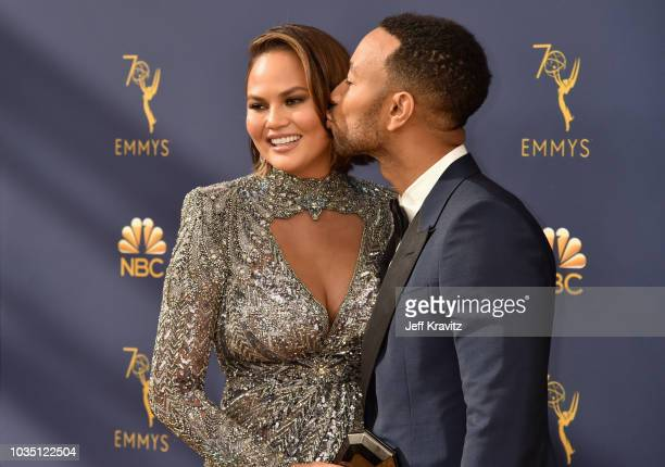 Chrissy Teigen and John Legend attend the 70th Emmy Awards at Microsoft Theater on September 17 2018 in Los Angeles California
