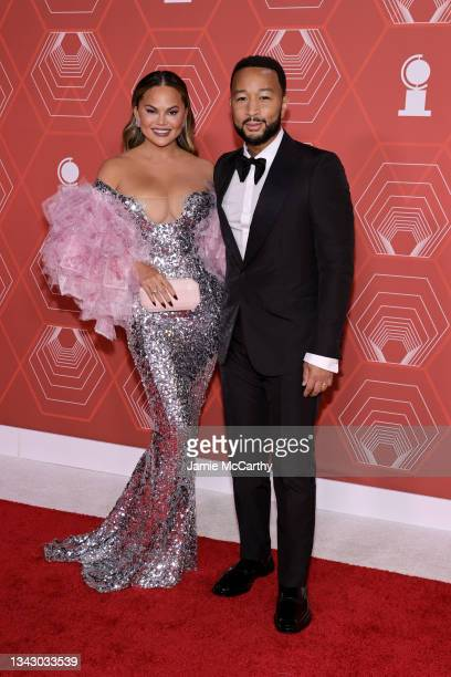 Chrissy Teigen and John Legend attend the 74th Annual Tony Awards at Winter Garden Theater on September 26, 2021 in New York City.