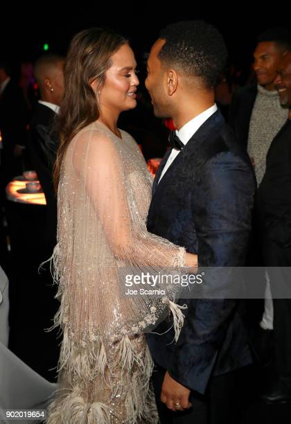 Chrissy Teigen and John Legend attend The Art Of Elysium's 11th Annual Celebration on January 6 2018 in Santa Monica California