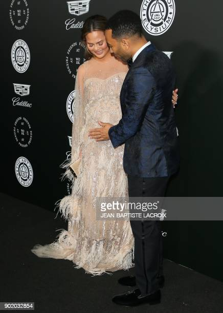 Chrissy Teigen and John Legend attend the Art of Elysium's 11th annual Heaven Gala in Santa Monica California on January 6 2018 / AFP PHOTO /...