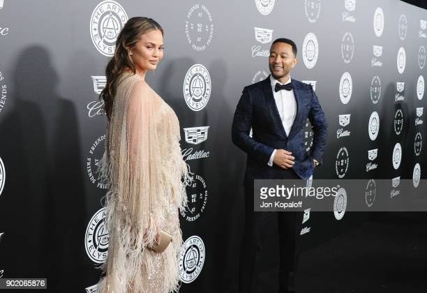Chrissy Teigen and John Legend attend The Art Of Elysium's 11th Annual Celebration Heaven at Barker Hangar on January 6 2018 in Santa Monica...