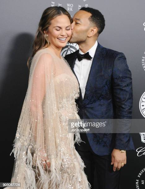 Chrissy Teigen and John Legend attend The Art Of Elysium's 11th Annual Celebration - Heaven at Barker Hangar on January 6, 2018 in Santa Monica,...