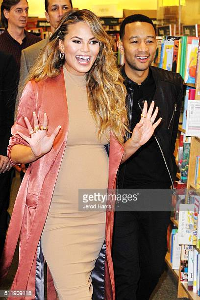 Chrissy Teigen and John Legend attend the book signing for Chrissy Teigen's new book 'Cravings Recipes For All The Food You Want To Eat' at Barnes...