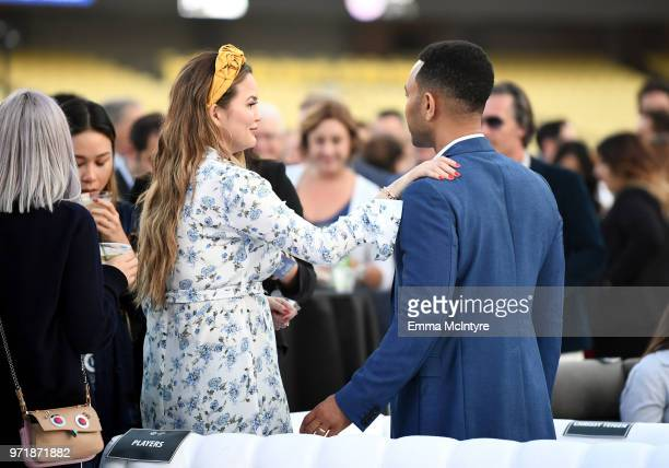 Chrissy Teigen and John Legend attend the Fourth Annual Los Angeles Dodgers Foundation Blue Diamond Gala at Dodger Stadium on June 11 2018 in Los...