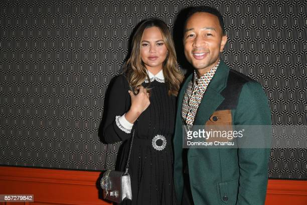 Chrissy Teigen and John Legend attend the Miu Miu aftershow party as part of the Paris Fashion Week Womenswear Spring/Summer 2018 at Boum Boum on...