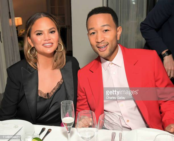 Chrissy Teigen and John Legend attend the Paul Smith Honors John Legend dinner on May 14 2019 in Los Angeles California