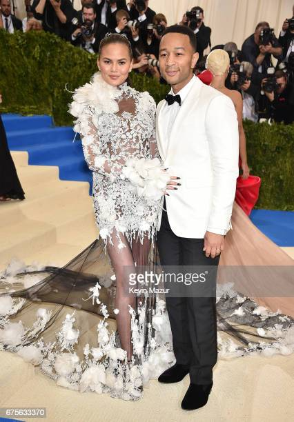 """Chrissy Teigen and John Legend attend the """"Rei Kawakubo/Comme des Garcons: Art Of The In-Between"""" Costume Institute Gala at Metropolitan Museum of..."""