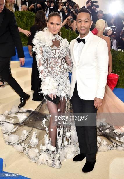 Chrissy Teigen and John Legend attend the Rei Kawakubo/Comme des Garcons Art Of The InBetween Costume Institute Gala at Metropolitan Museum of Art on...