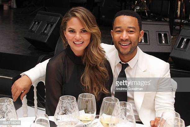 Chrissy Teigen and John Legend attend the White Party Dinner Hosted by Andrea and Veronica Bocelli Celebrating Celebrity Fight Night In Italy...
