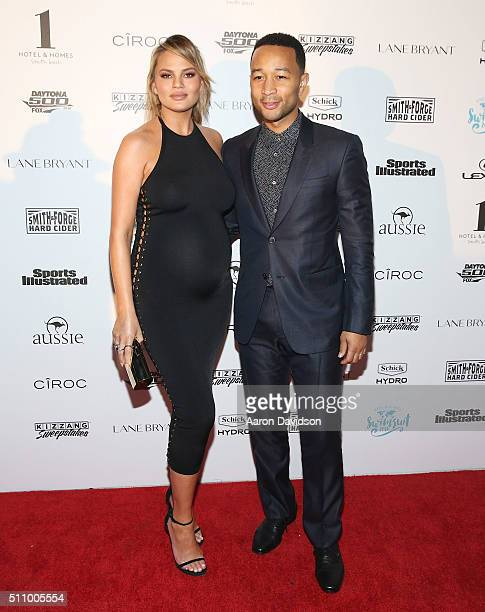 Chrissy Teigen and John Legend attends Sports Illustrated Swimsuit 2016 Swim BBQ VIP at 1 Hotel Homes South Beach on February 17 2016 in Miami Beach...