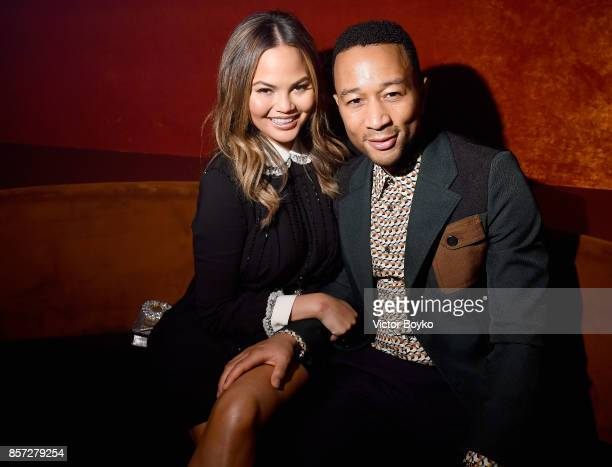 Chrissy Teigen and John Legend attends the Miu Miu aftershow party as part of the Paris Fashion Week Womenswear Spring/Summer 2018 at Boum Boum on...