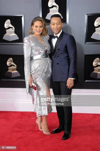 Chrissy Teigen and John Legend on the red carpet at THE 60TH ANNUAL GRAMMY AWARDS broadcast live on both coasts from New York City's Madison Square...