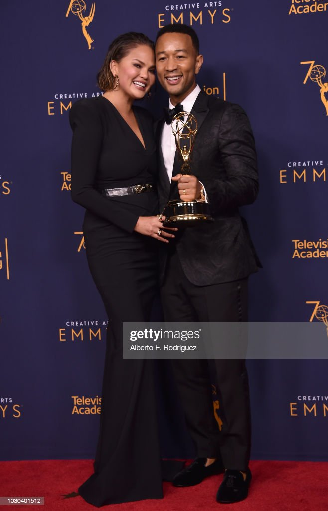 Chrissy Teigen and John Legend pose in the press room during the 2018 Creative Arts Emmys at Microsoft Theater on September 9, 2018 in Los Angeles, California.