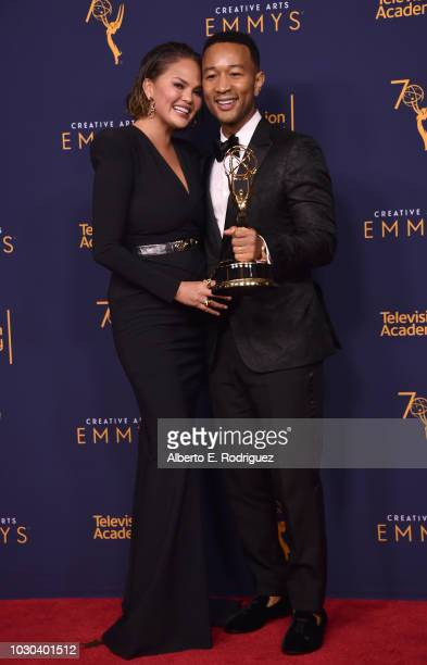 Chrissy Teigen and John Legend pose in the press room during the 2018 Creative Arts Emmys at Microsoft Theater on September 9 2018 in Los Angeles...