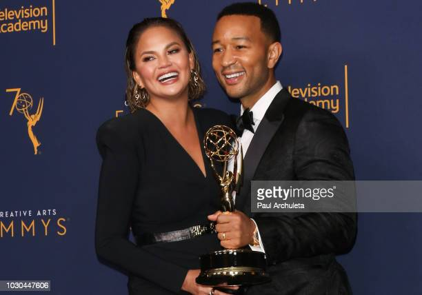 Chrissy Teigen and John Legend pose in the press room of the 2018 Creative Arts Emmy Awards Day 2 at Microsoft Theater on September 9 2018 in Los...