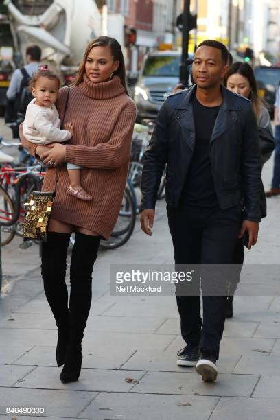 Chrissy Teigen and John Legend seen leaving an office building with their daughter Luna on September 13 2017 in London England