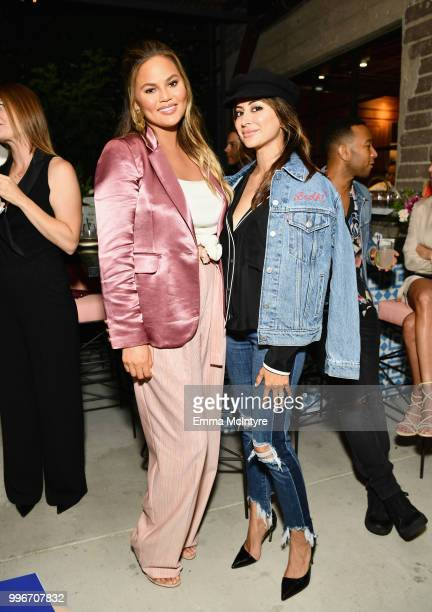 Chrissy Teigen and Noureen DeWulf attend the Finery App launch party hosted by Brooklyn Decker at Microsoft Lounge on July 11 2018 in Culver City...