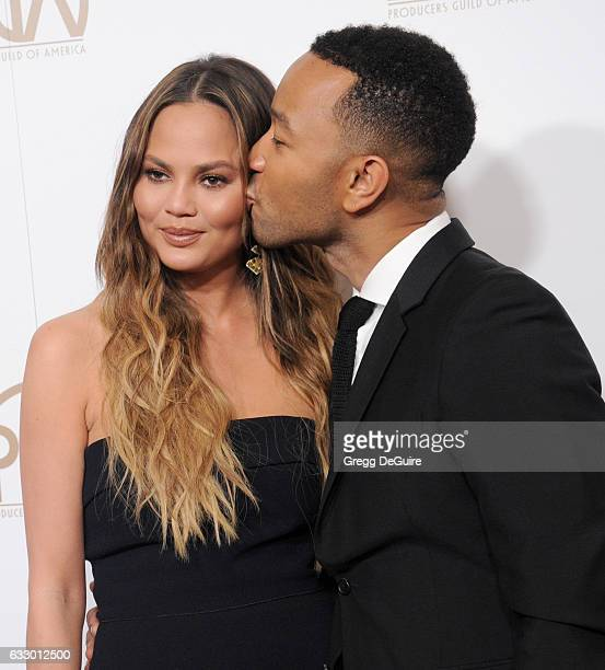 Chrissy Teigen and singer John Legend arrive at the 28th Annual Producers Guild Awards at The Beverly Hilton Hotel on January 28 2017 in Beverly...