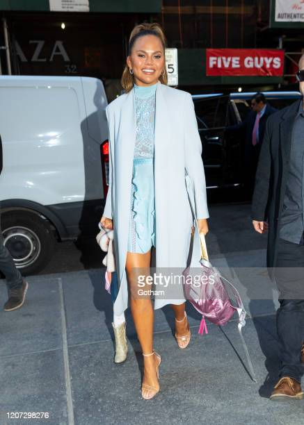 Chrissy Teigen arrives at NBC studios with daughter Luna on February 19 2020 in New York City