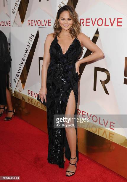 Chrissy Teigen arrives at #REVOLVEawards at DREAM Hollywood on November 2 2017 in Hollywood California