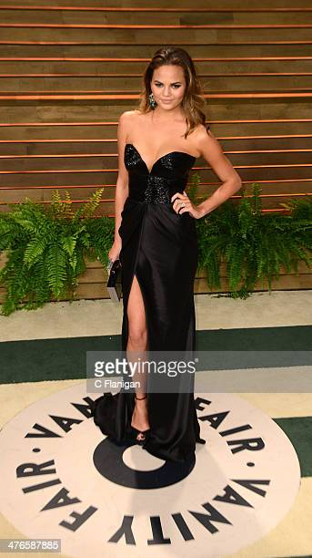 Chrissy Teigen arrives at the 2014 Vanity Fair Oscar Party Hosted By Graydon Carter on March 2 2014 in West Hollywood California