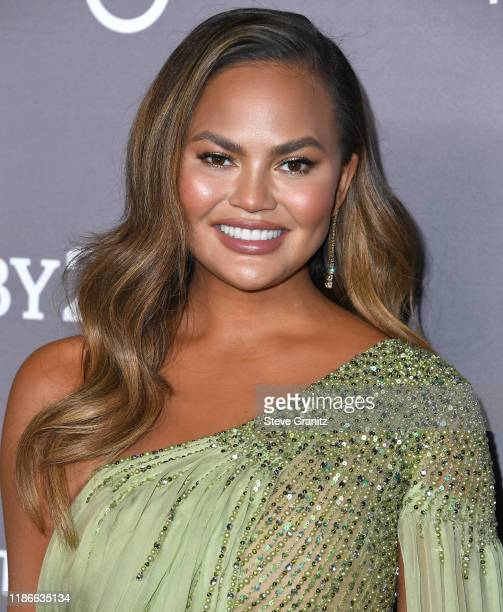 Chrissy Teigen arrives at the 2019 Baby2Baby Gala Presented By Paul Mitchell at 3LABS on November 09, 2019 in Culver City, California.