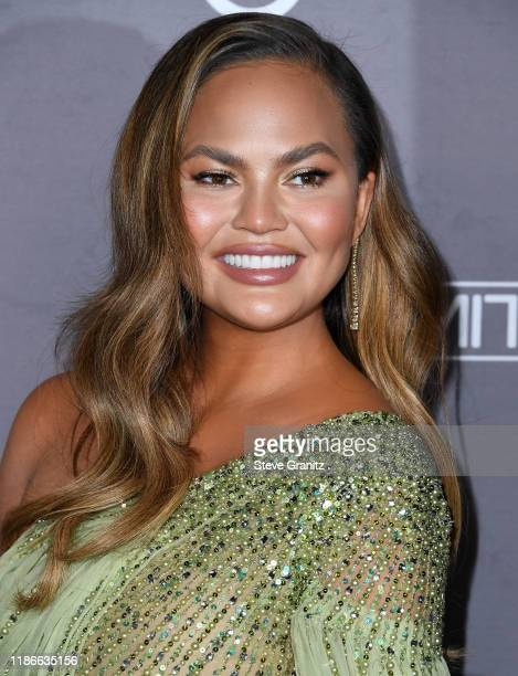 Chrissy Teigen arrives at the 2019 Baby2Baby Gala Presented By Paul Mitchell at 3LABS on November 09 2019 in Culver City California