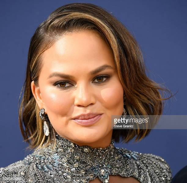 Chrissy Teigen arrives at the 70th Emmy Awards on September 17 2018 in Los Angeles California