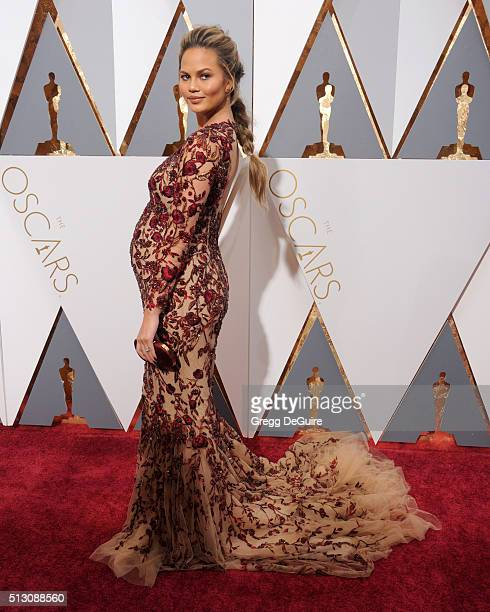 Chrissy Teigen arrives at the 88th Annual Academy Awards at Hollywood Highland Center on February 28 2016 in Hollywood California