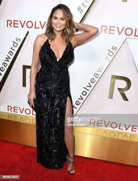 Chrissy Teigen arrives at the #REVOLVEawards at DREAM Hollywood on November 2 2017 in Hollywood California