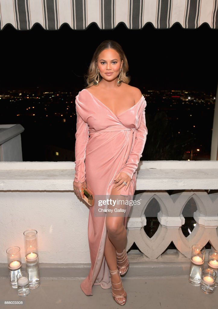 Chrissy Teigen attends GQ and Dior Homme private dinner in celebration of The 2017 GQ Men Of The Year Party at Chateau Marmont on December 7, 2017 in Los Angeles, California.