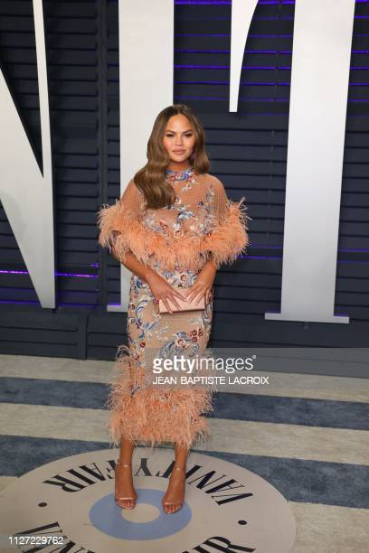 Chrissy Teigen attends the 2019 Vanity Fair Oscar Party at the Wallis Annenberg Center for the Performing Arts on February 24 2019 in Beverly Hills...