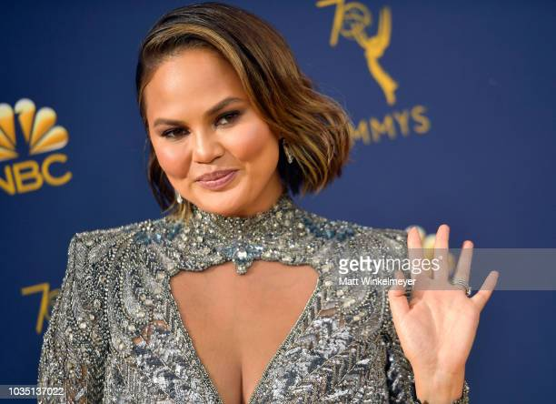 Chrissy Teigen attends the 70th Emmy Awards at Microsoft Theater on September 17 2018 in Los Angeles California
