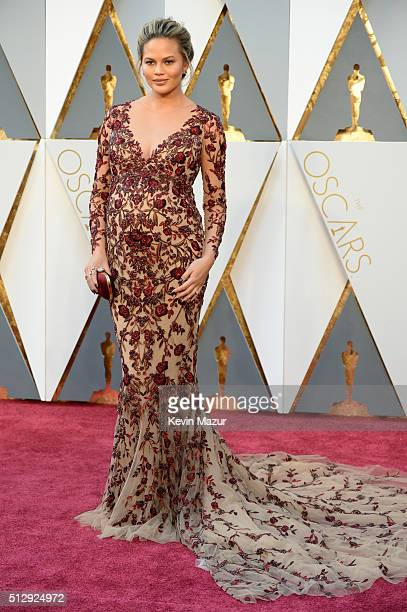 Chrissy Teigen attends the 88th Annual Academy Awards at Hollywood Highland Center on February 28 2016 in Hollywood California