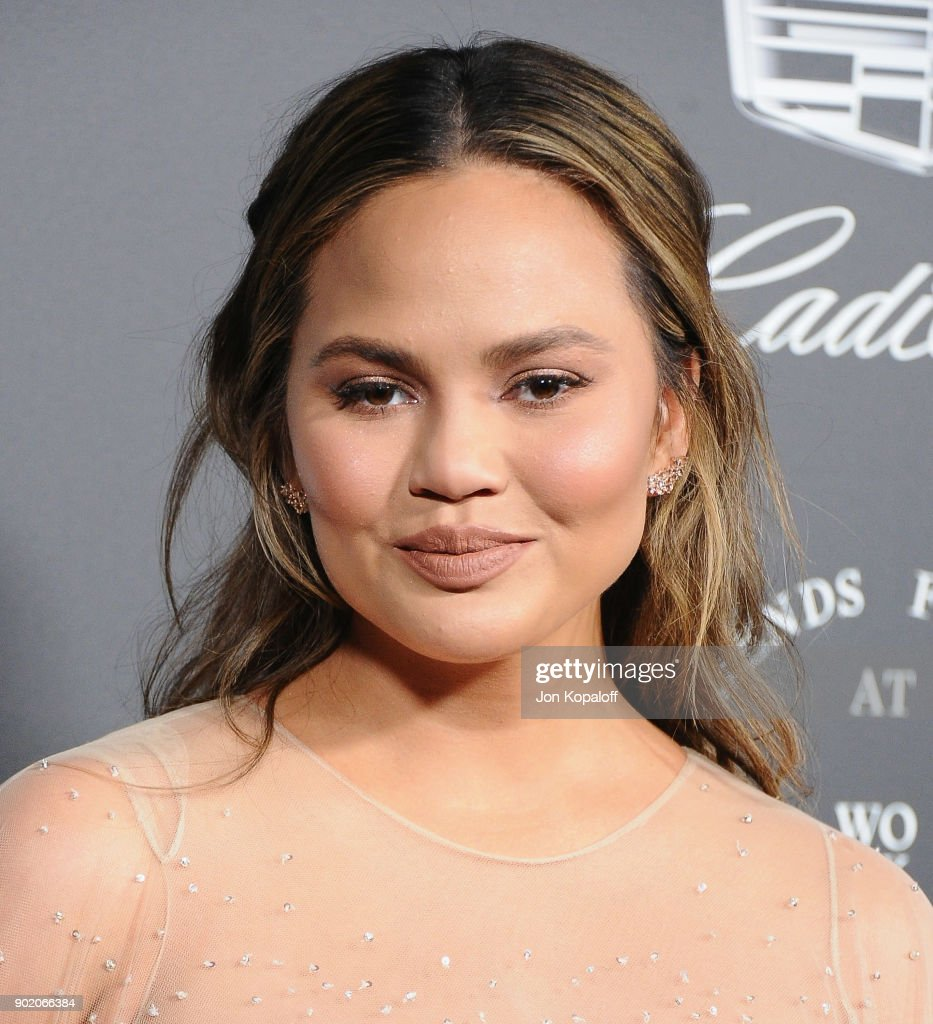Chrissy Teigen attends The Art Of Elysium's 11th Annual Celebration - Heaven at Barker Hangar on January 6, 2018 in Santa Monica, California.