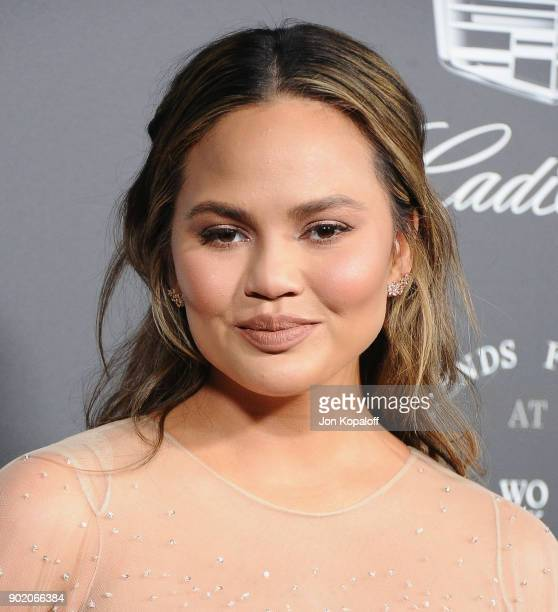 Chrissy Teigen attends The Art Of Elysium's 11th Annual Celebration Heaven at Barker Hangar on January 6 2018 in Santa Monica California